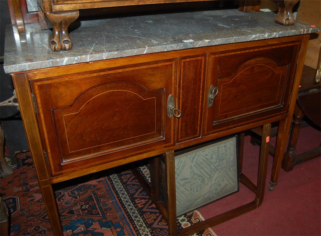 An Edwardian mahogany and satinwood inlaid swing mirror back marble topped washstand