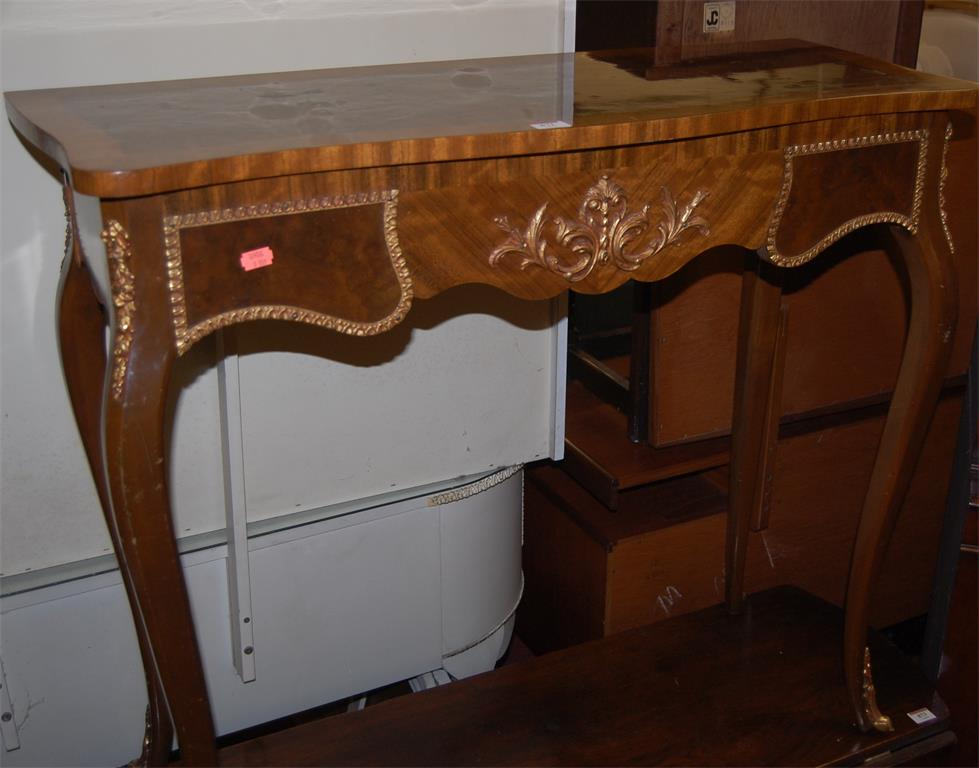 A French style figured walnut, crossbanded and further gilt metal mounted hall table