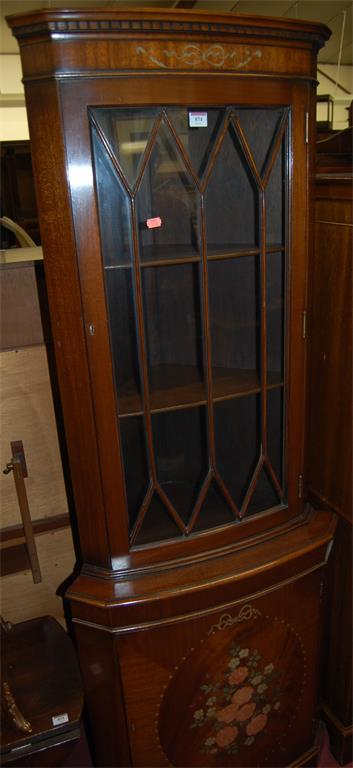 A reproduction mahogany freestanding corner cupboard