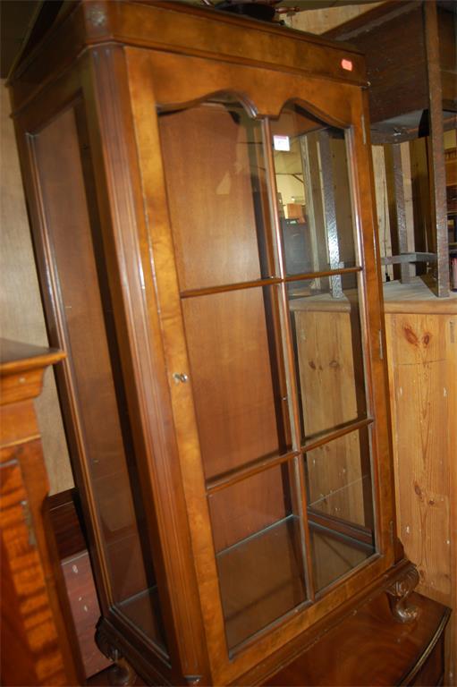 A figured walnut single door glazed china display cabinet