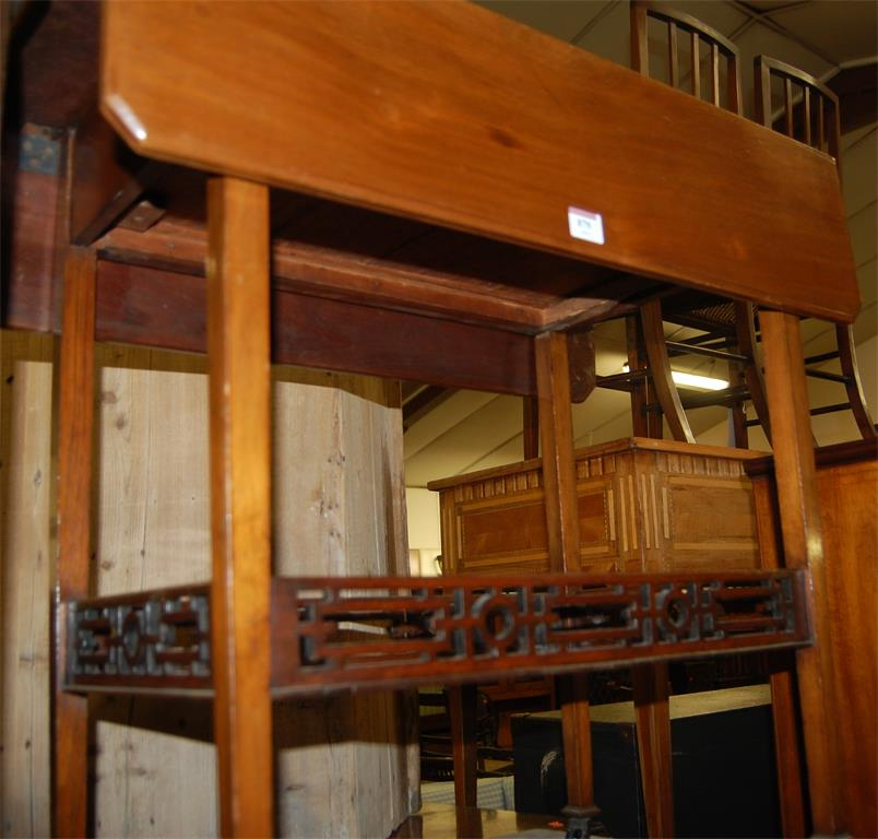 An Edwardian walnut dropflap two tier occasional table, having single end drawer; together with an oak sewing table (2)