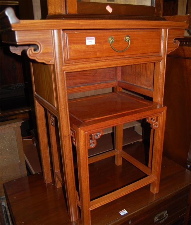 A contemporary Chinese hardwood single drawer side table; together with a matching occasional table (2)