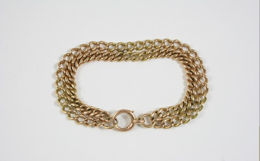 A 15CT. GOLD TWO ROW CURB LINK BRACELET