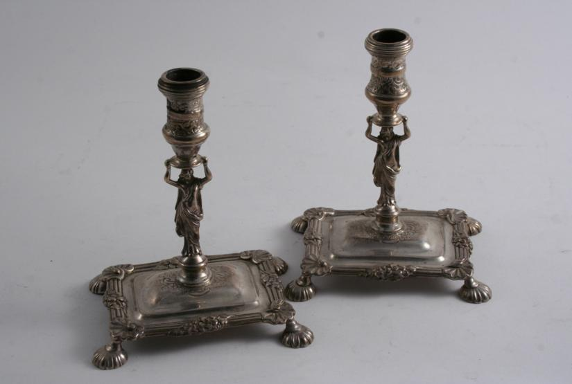 A PAIR OF LATE 18TH / EARLY 19TH CENTURY CAST CANDLESTICKS