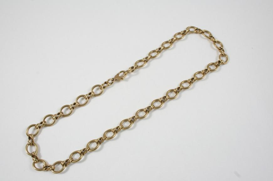 A GOLD FANCY LINK NECKLACE