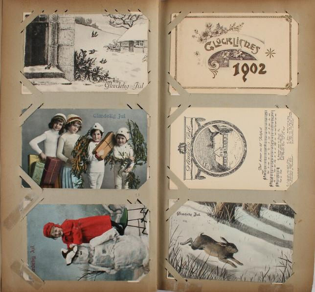Postcards. Christmas and New Year. Old album with collection, approx. 300 cards from period 1904-49 incl. better. Please se scan