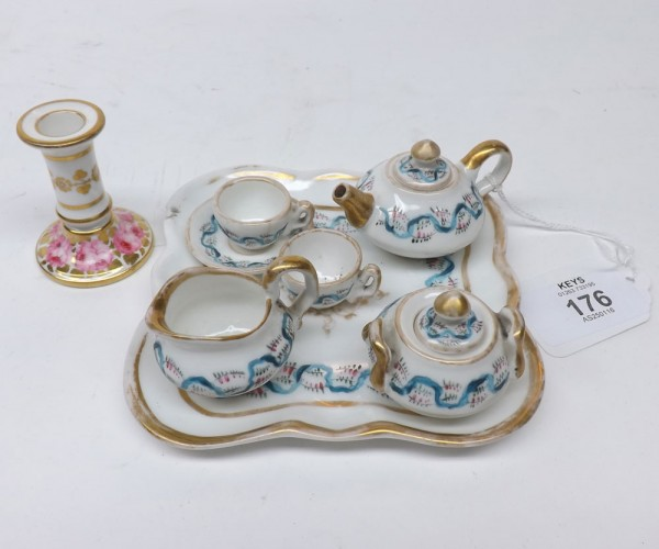 Late 19th or early 20th century continental miniature three piece tea service, with two accompanying cups, single saucer and tra