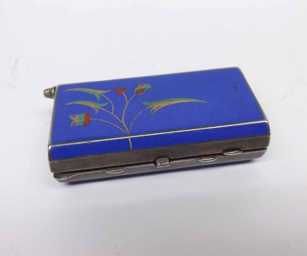 20th century continental silver and enamelled travelling compact, of hinged rectangular form, the body decorated with stylised f