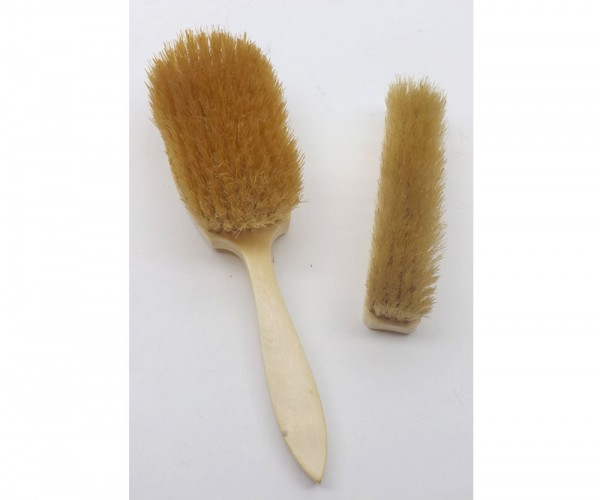 "Two 19th century ivory backed dressing table brushes, largest 10"" long"
