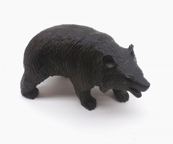 """Small black forest type carved softwood model of a bear, 5"""" long"""