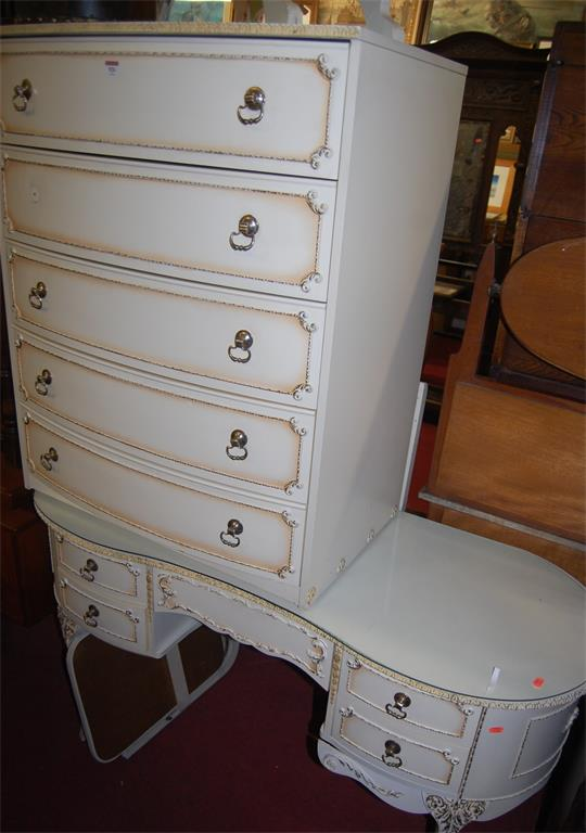 A modern white wood bowfront chest of five long drawers