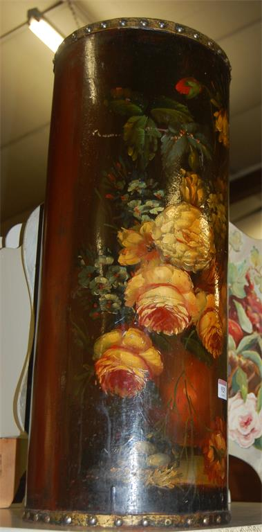 A floral polychrome painted and metal studded cylindrical stickstand