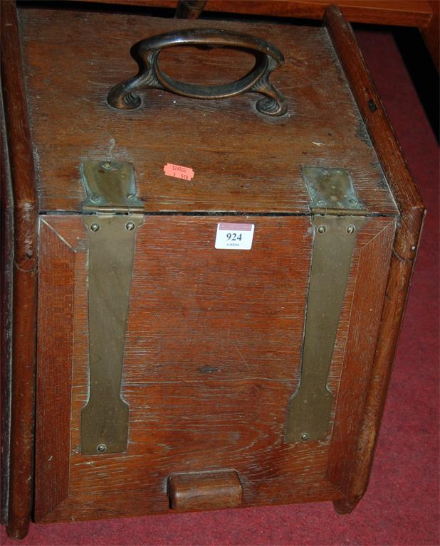 An early 20th century oak and metal bound coal purdonium with shovel