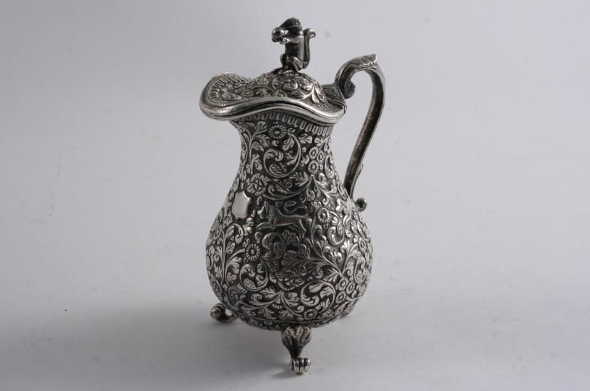 A LATE 19TH CENTURY INDIAN MILK JUG