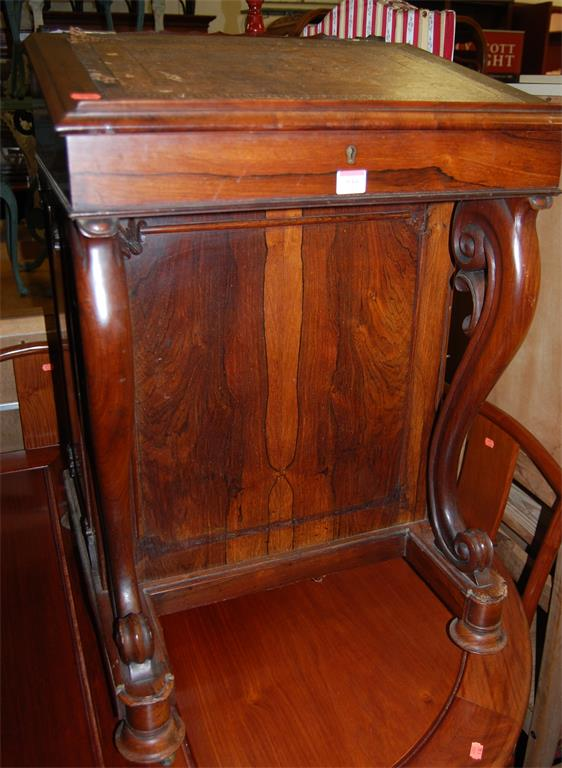 An early Victorian rosewood slopefront davenport