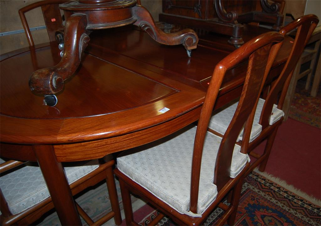 A contemporary Chinese hardwood dining suite comprising