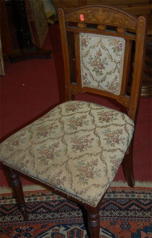 A set of four Edwardian mahogany and satinwood inlaid floral upholstered salon chairs