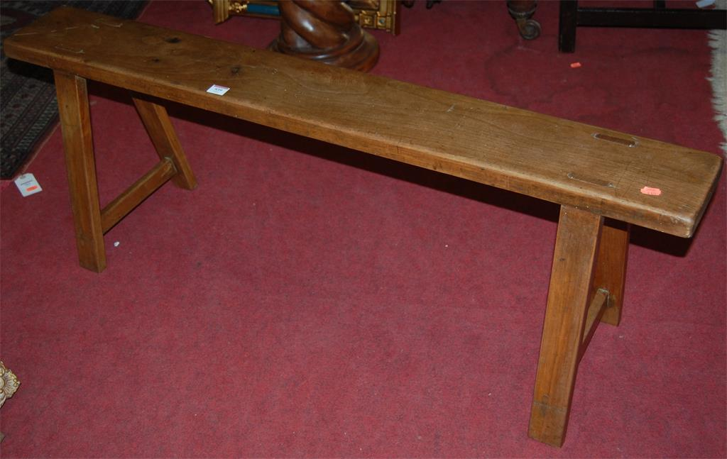 A joined elm long work stool