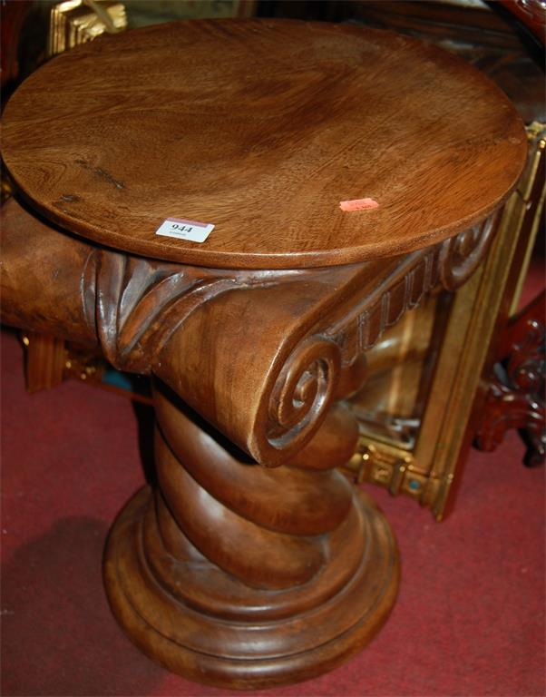 A hardwood stool; together with a Chippendale style floral decorated oval wall mirror