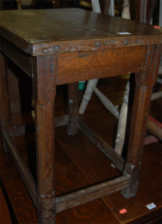 An antique joined oak rectangular occasional table, having cleated ends