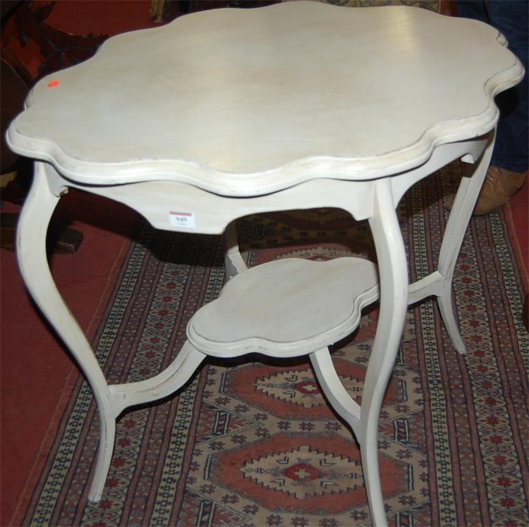 An Edwardian shaped top and white painted two tier occasional table