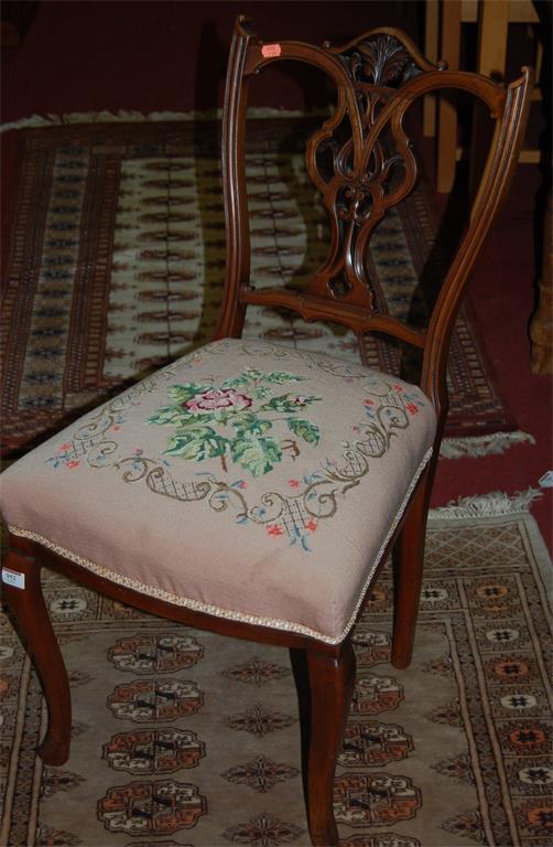 A pair of Edwardian walnut salon chairs