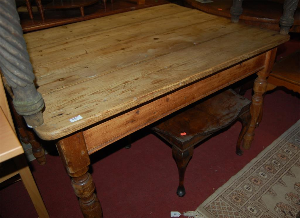 A Victorian rustic pine round cornered plank-top kitchen table