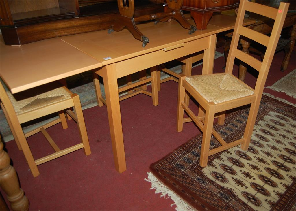 A modern beech drawleaf dining table