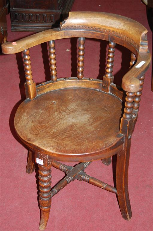 An early 20th century elmseat and walnut tub elbow chair