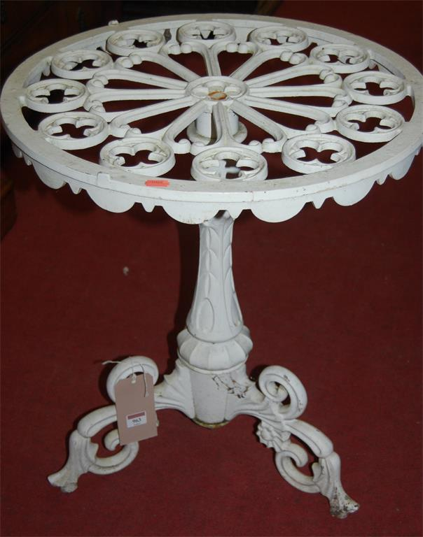 A pair of Victorian style white painted cast iron circular garden occasional tables, each with pierced floral decoration