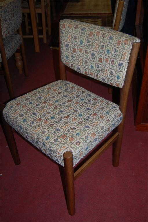 A set of six 1960s Danish hardwood and floral upholstered pad- back and seat dining chairs