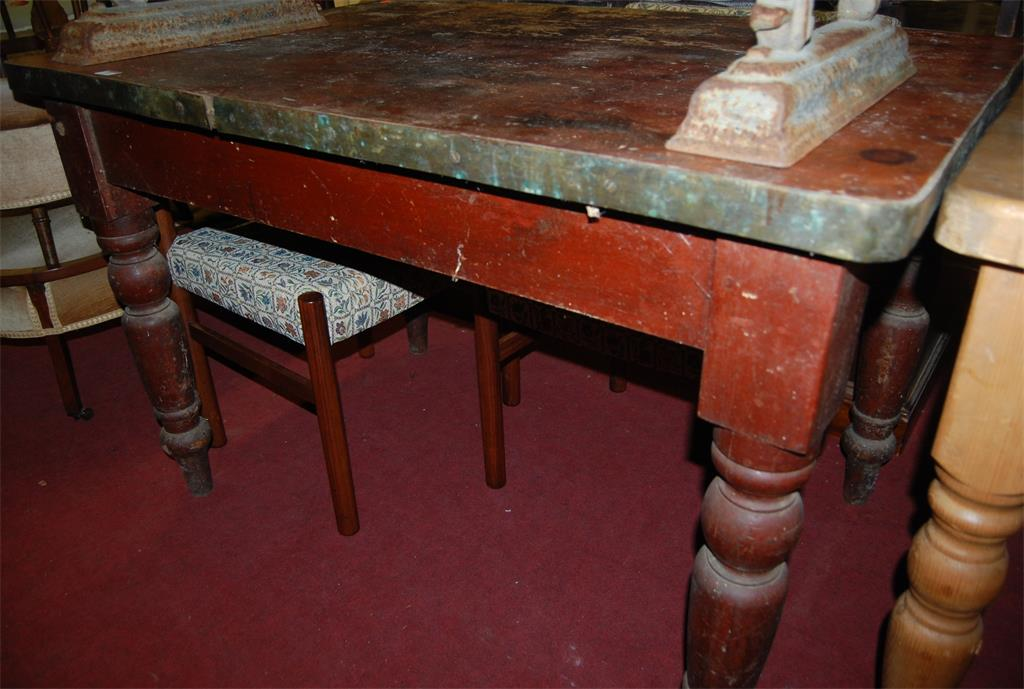 A Victorian stained pine round cornered and metal bound farmhouse style kitchen table