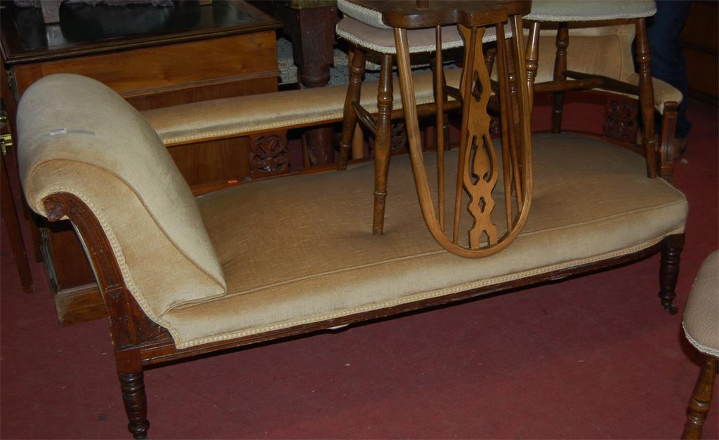 An Edwardian walnut framed and mustard upholstered day-bed