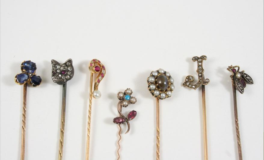 SEVEN ASSORTED GOLD AND GEM SET STICK PINS