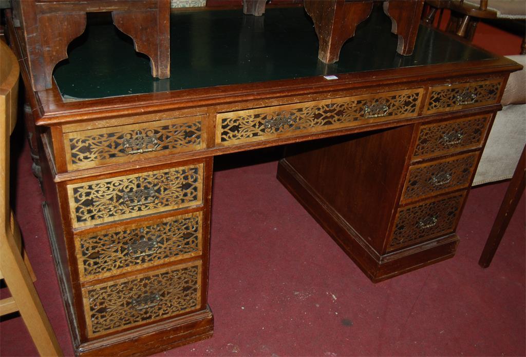 A Victorian walnut twin pedestal writing desk