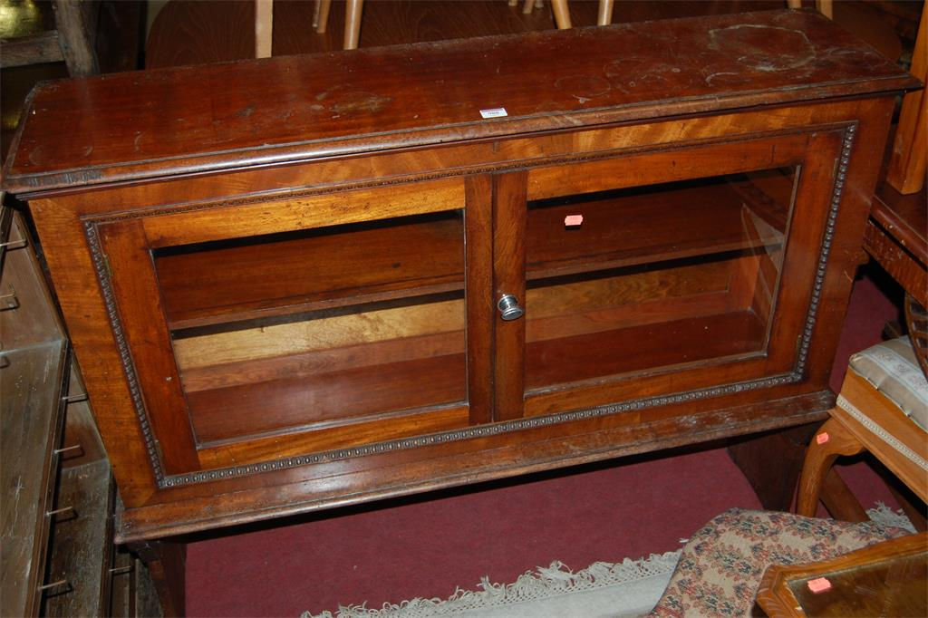 A late Victorian mahogany double door glazed side cabinet