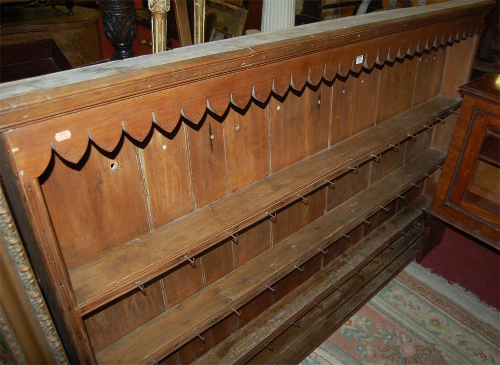 A 19th century pine three tier plate-rack
