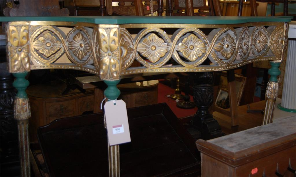 A floral gilded and green painted serpentine console table