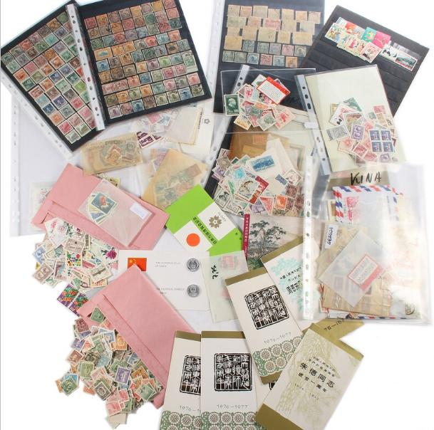 China. Small box with stamps in stockpages and others