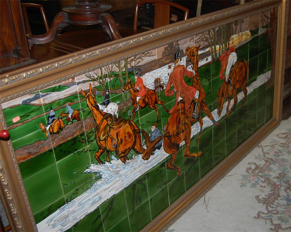 An extremely large contemporary gilt framed tile inset wall panel, depicting hunting scene within a landscape