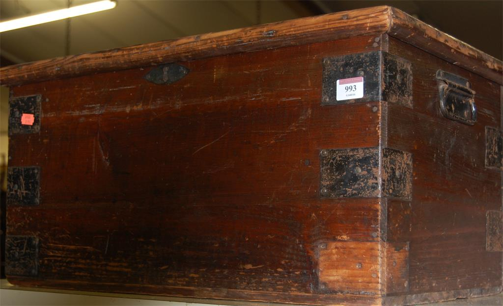 A 19th century stained pine hinge-top and metal bound tool chest