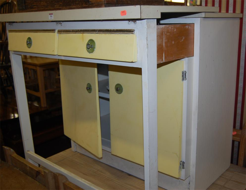 A 1950s formica and painted double door kitchen cupboard, having pull-out front section