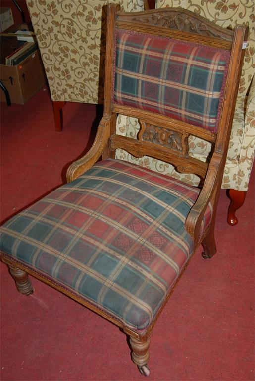An Edwardian carved oak and upholstered single ladies parlour chair