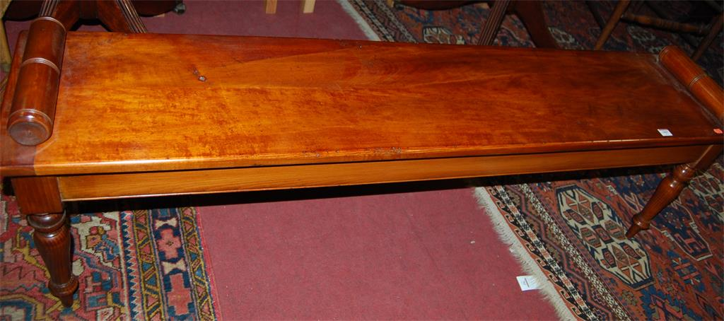 A Victorian style fruitwood long window seat, having typical rolled ends