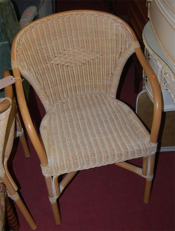 A set of six contemporary bamboo and wicker conservatory elbow chairs; together with one other bamboo chair