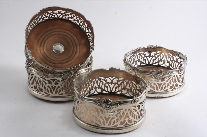 A SET OF FOUR VICTORIAN ELECTROPLATED WINE COASTERS