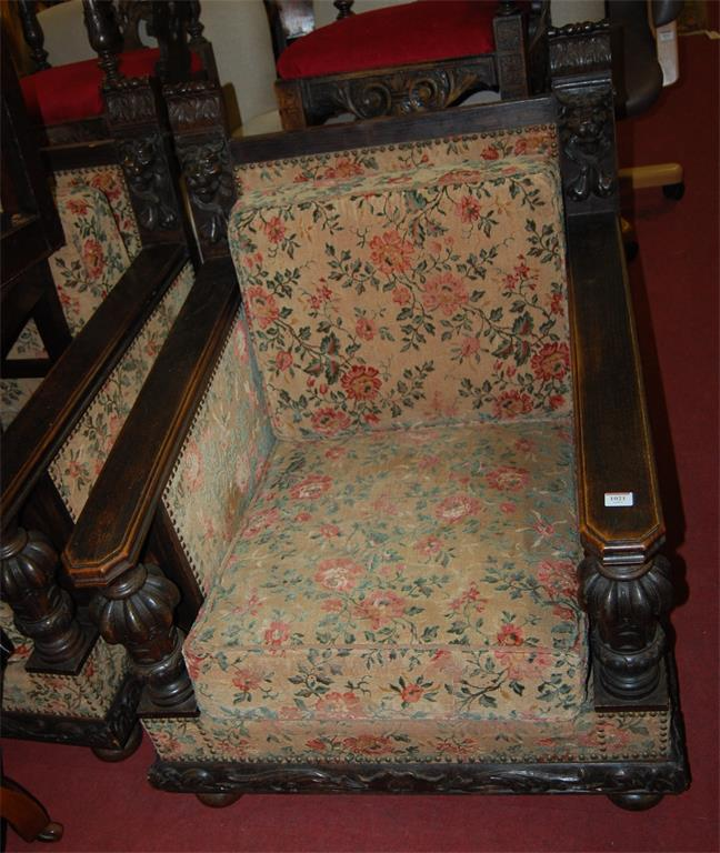 A pair of circa 1900 Continental carved oak, floral upholstered