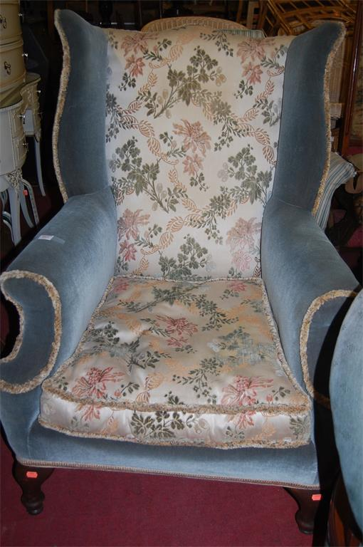 A circa 1900 walnut framed and floral upholstered wingback armchair