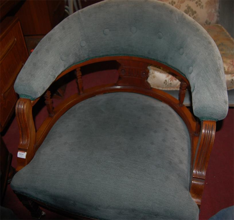 A pair of Edwardian walnut framed and blue buttonback upholstered tub chairs
