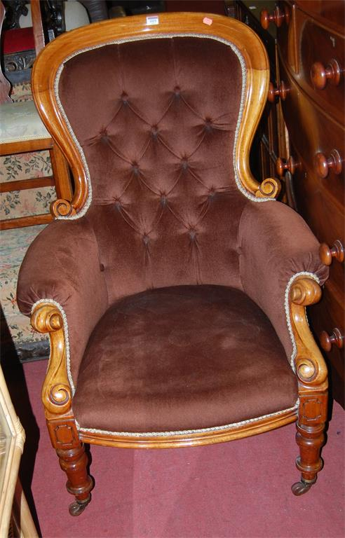 A Victorian mahogany and brown buttonback upholstered gentlemans spoonback armchair